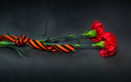 George Ribbon and flowers in memory of the victory in World War II Stock Photo