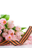 George ribbon and pink tulips Royalty Free Stock Photo