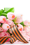 George ribbon and pink tulips Stock Image