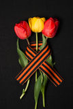 George ribbon, red and yellow tulips Stock Photography