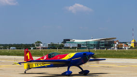 George Rotaru (Leader) with YR-EXA. George Rotaru (Hawks of Romania) with YR-EXA after aerobatics at Bucharest International Air Show 2013 royalty free stock photos