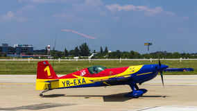 George Rotaru (Leader) with YR-EXA. George Rotaru (Hawks of Romania) with YR-EXA after aerobatics at Bucharest International Air Show 2013 royalty free stock image