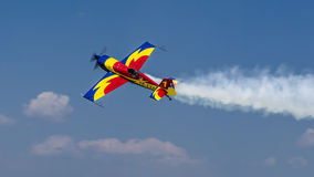 George Rotaru with YR-EXA. George Rotaru (Hawks of Romania) with YR-EXA during aerobatics at AeroNautic Show 2013 - Morii Lake, Bucharest royalty free stock image