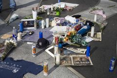 George Steinbrenner memorial. Bronx York, NY - July 15: Flowers and candles placed on the NY Yankees logo to honor and remember Yankees manager George Stock Images