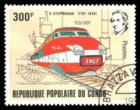 George Stephenson train TGV. Stamp printed by Congo, Color edition on topic of Railway devoted 200th birthday of George Stephenson, shows train TGV 001, CIRCA Royalty Free Stock Photos