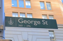 George street sign Sydney Australia. George street sign in Sydney Australia. George street is the main street with shopping malls and office buildings in Royalty Free Stock Image