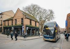 George Street Social Pub and doube-decker bus in Oxford. OXFORD, UNITED KINGDOM - MAR 5, 2017: George Street Social Pub and doube-decker bus on the  35 New Inn Stock Photography