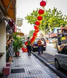 Red Chinese lanterns hanging in a street royalty free stock image