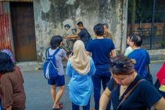 George Town, Malaysia - 10. März 2017: Kleine Kinder auf einem Fahrrad, populäre Wandstraßenkunst die unbekannte Touristen Lizenzfreies Stockbild
