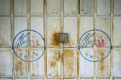 Old wooden door with lock stock image