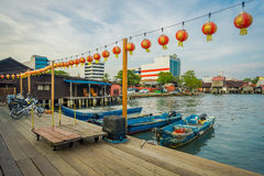 George Town, Malaysia - March 10, 2017: Clan Jetties are unique Chinese settlements existing since the 19th century. Along these wooden pier are villages that Stock Photography