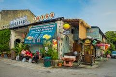 George Town Malaysia - mars 10, 2017: Streetscapesikten av shoppar och dagligt liv av den andra - största staden i Malaysia Royaltyfri Foto