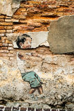 George Town Penang Malaysia aged graffito of boy July 2015. George Town Penang Malaysia aged graffito of boy on a brick wall July 2015 Stock Photos