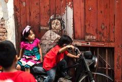 George Town Penang Malaysia envejeció la pintada ciclista de julio de 2015 Fotografía de archivo libre de regalías