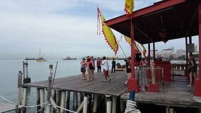Tourist visit temple at Chew Jetty.