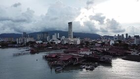 Aerial view Chew Jetty crowded by tourists in cloudy day.