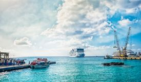 George Town Port-Marine Shuttle. Grand Cayman, Cayman Islands, tourists in the Caribbean embarking on a marine shuttle for their cruise ship, moored at George stock image