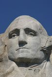 George Washington. Mt. Rushmore in August with a beautiful blue sky in the background Stock Image