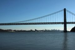 George Washington Bridge. With Manhattan skyline and blue sky in the background Royalty Free Stock Photography
