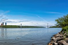 The George Washington Bridge, GWB, connecting Upper Manhattan and New Jersey, with the Hudson River in the foreground stock photos