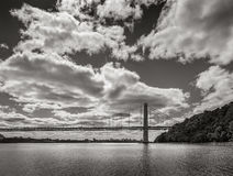 George Washington Bridge and Hudson River. New York City. George Washington Bridge spanning Hudson River with clouds in Black & White. New York City Stock Image