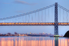George Washington Bridge with NYC skyline at dusk. With evening light reflecting in Hudson river stock photo