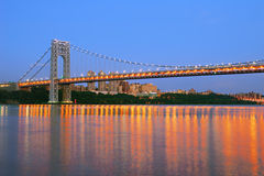 George Washington Bridge with NYC skyline at dusk Stock Images
