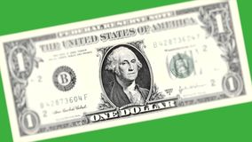 George Washington on a dollar bill. Rotating closeup of George Washington one dollar bill on the green background. US money close-up - 4k video stock footage