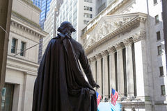 George Washington observing the New York Stock Exchange building Royalty Free Stock Image
