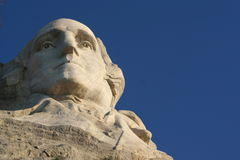 George Washington at Rushmore. The face of President George Washington protrudes from a granite mountain at Mount Rushmore National Memorial Stock Photography