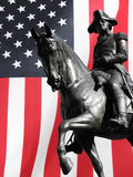 George Washington statue. Closeup of George Washington on horse statue with American flag in background royalty free stock photo
