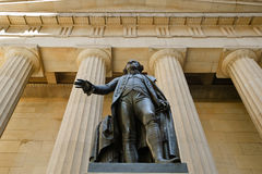 George Washington Statue & Federal Hall National M. Statue of George Washington in front of the Federal Hall monuments stone facade and entablatures. Memorials Royalty Free Stock Images