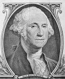 George Washington stående på en dollarräkning Arkivbild