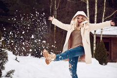 Georgeous elegant blonde in bright winter dress Royalty Free Stock Photos
