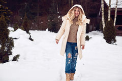 Georgeous elegant blonde in bright winter dress Stock Photography