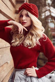 Georgeous elegant blonde in red dress and hat Royalty Free Stock Photo