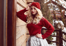 Georgeous elegant blonde in red dress and hat Stock Images
