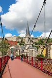 Georges footbridge over Saone river and St. Georges church, Lyon Stock Photos
