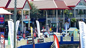 Georgetown Grand Cayman Island. Shopping tourists Pirates week flags harbor Cayman Airways rum stock photo