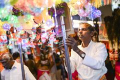 Devotee set up for before Thaipusam procession. Georgetown,Penang.Malaysia – CIRCA JAN 2016: Devotee set up for before Thaipusam procession Royalty Free Stock Images