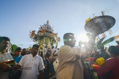 An unidentified Devotee carry offering with silver chariot at the back,. Georgetown,Penang.Malaysia – CIRCA JAN 2016:An unidentified Devotee carry offering Stock Image