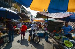 Awkers and pubic in morning market Chowrasta Market. GEORGETOWN, PENANG/MALAYSIA – CIRCA MARCH 2016: Hawkers and pubic in morning market Chowrasta Market royalty free stock image