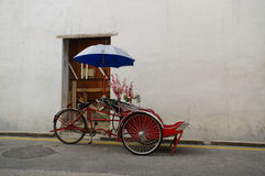 Georgetown, Penang, Malaysia - April 18, 2015: Classic local rickshaw in George Town. royalty free stock image