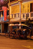 Georgetown, Penang, Malaysia - April 18, 2015: Classic local rickshaw in George Town by night. royalty free stock photos