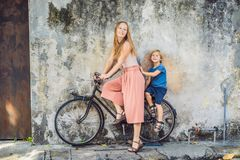 Georgetown, Penang, Malaysia - April 20, 2018: Mother and son on a bicycle. Public street art Name Children on a bicycle painted 3. D on the wall that`s two royalty free stock photography
