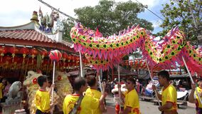 Dragon dance at outdoor of Chew Jetty temple.