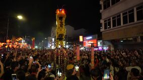 LED Lion dance jump on stilt at Chew Jetty during chinese new year.
