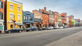 Georgetown shopping district along M Street. WASHINGTON DC - MAY, 6, 2018: Georgetown shopping district along M Street. M street hosts a large variety of shops stock photography