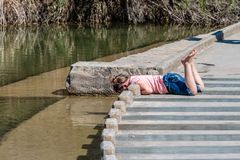 Young Girl Playing on the Low Water Crossing stock photography