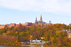 Georgetown University buildings in fall along the Potomac River. Stock Photography
